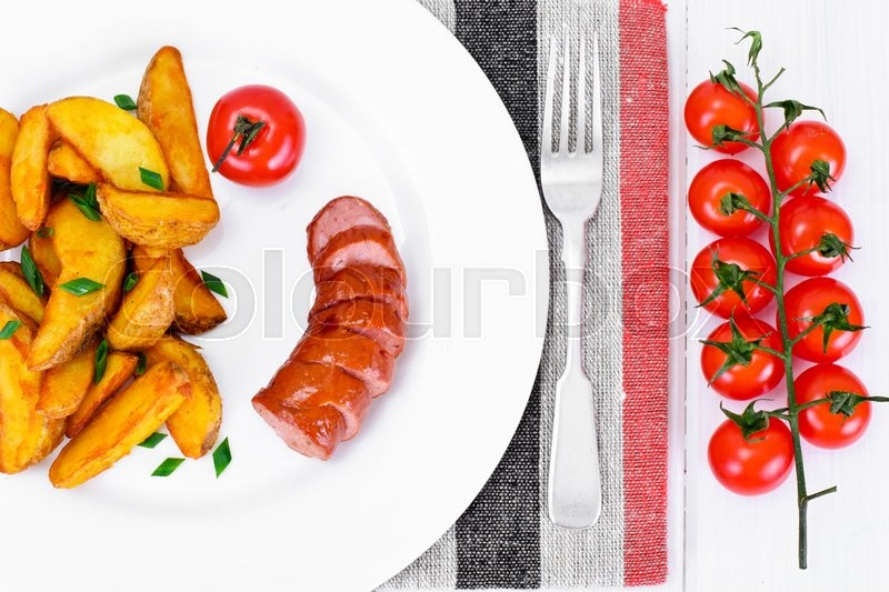 Stock image of 'Fried Potato Wedges in a Rural and Sausage Studio Photo'