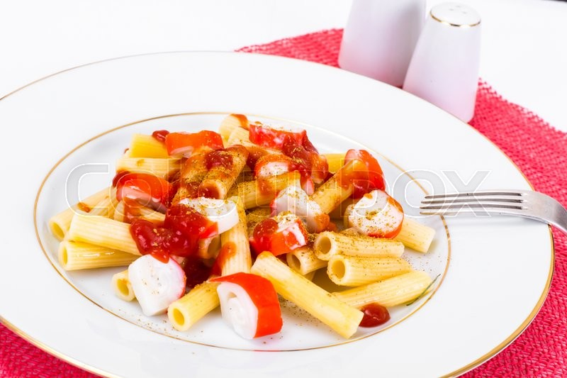 Stock image of 'Pasta with Ketchup and Crab Sticks Studio Photo'