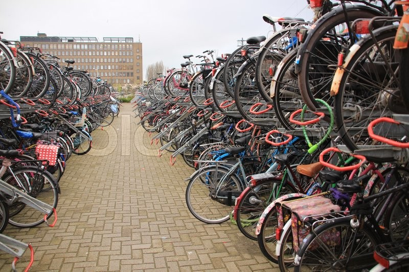 Stock image of 'Many bikes on the biking place at the railway station in the city Leiden in spring.'