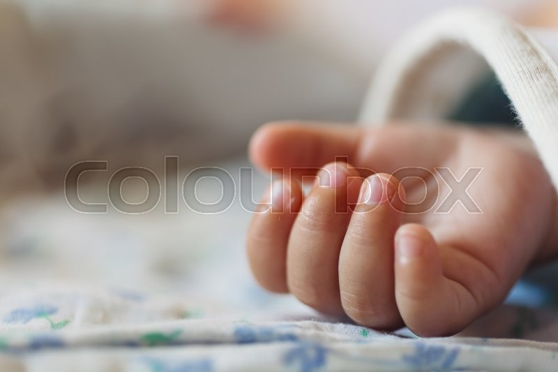 Stock image of 'the palm of a sleeping child. Close-up'