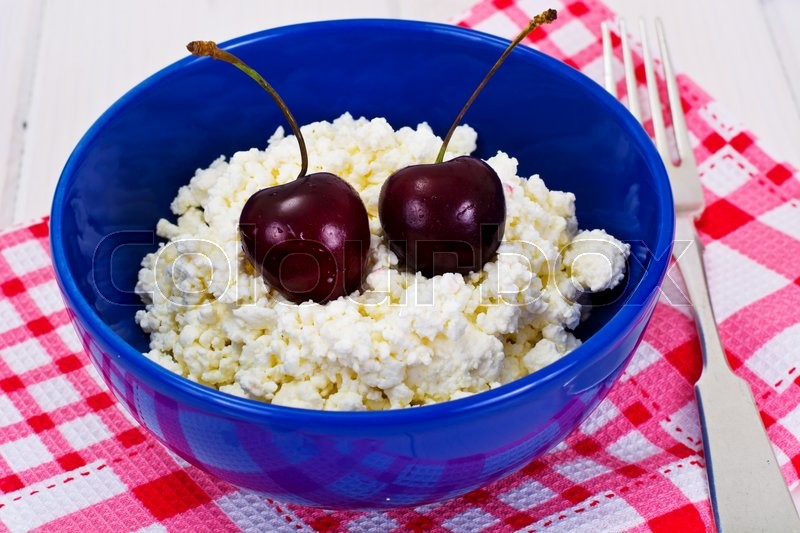 Stock image of 'Home Dietary Fat Cottage Cheese Beaded Curd with Cherries Studio Photo'