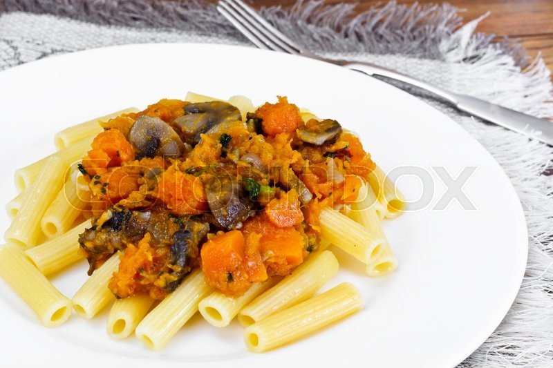 Stock image of 'Pasta with Baked Pumpkin with Mushrooms and Vegetables. Vegetarian Food. Studio Photo'