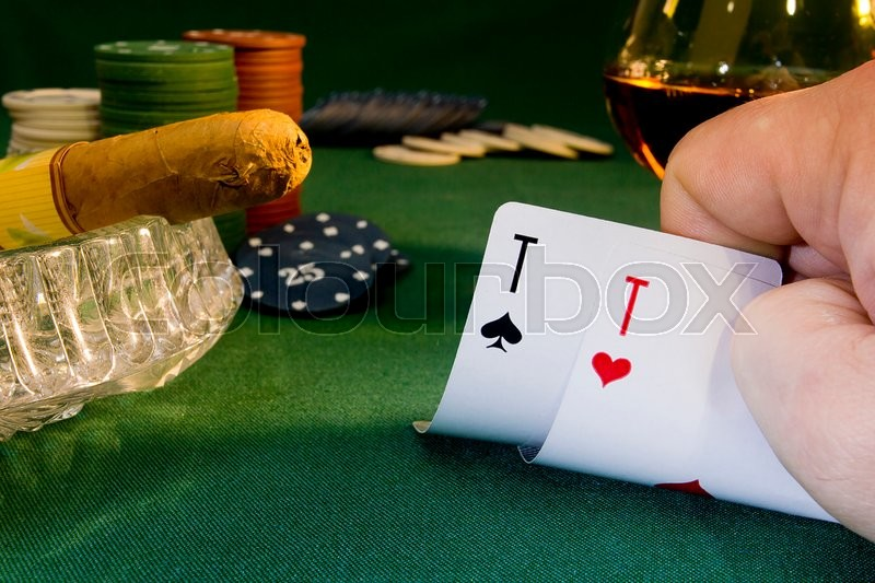 Stock image of 'Poker concept with chips and cards on the green table cigar'