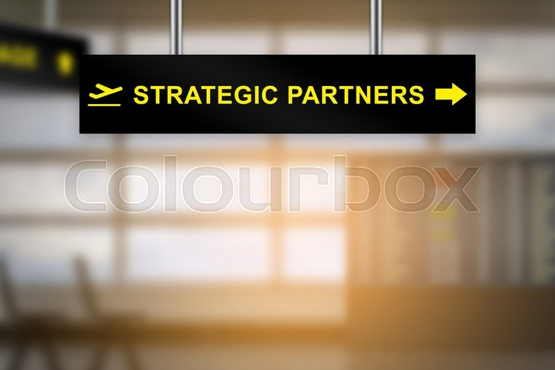 Stock image of 'strategic partners on airport sign board with blurred background and copy space'