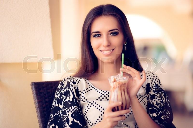 Stock image of 'Portrait of a beautiful girl with frappuccino outside in summertime'