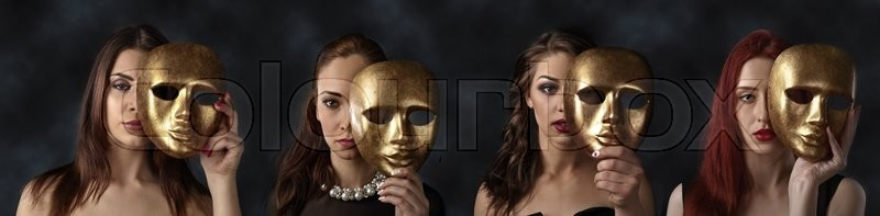 Stock image of 'four women hiding faces behind golden masks'