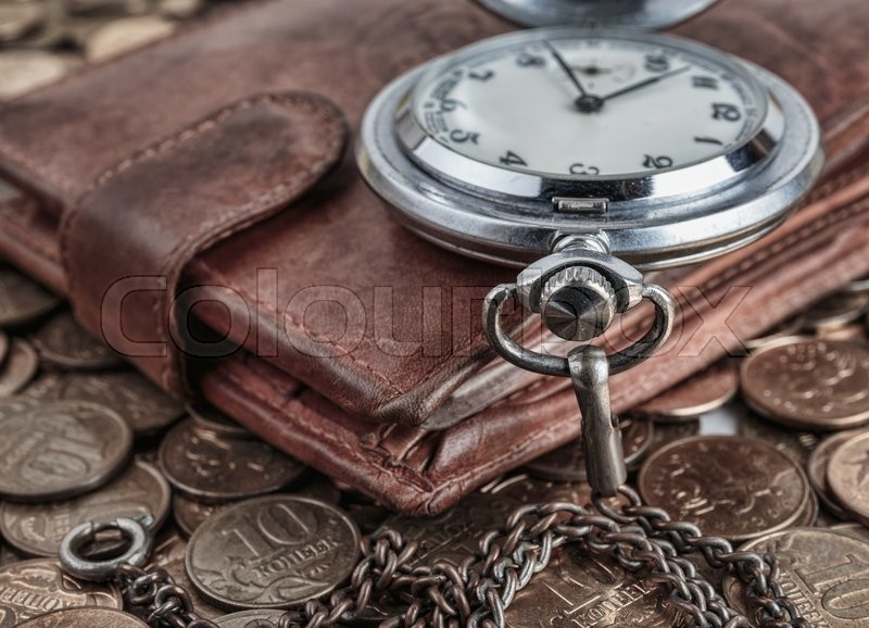 Stock image of 'Wallet and pocket watch on the coins background'