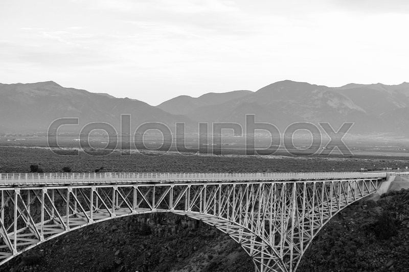 Stock image of 'A bridge made of iron in the middle of a desert in the United States'