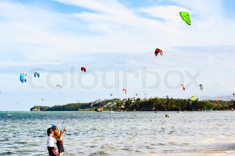 Editorial image of 'BORACAY, PHILIPPINES - JANUARY 7, 2015 - A tourist takes Kitesurfing lessons from a teacher on the shore in the island of Boracay.'