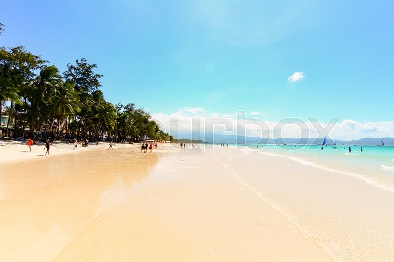 Stock image of 'BORACAY, PHILIPPINES - JANUARY 10, 2015 - An overview of the White Beach of Boracay , with many tourists relax by walking or swimming.'