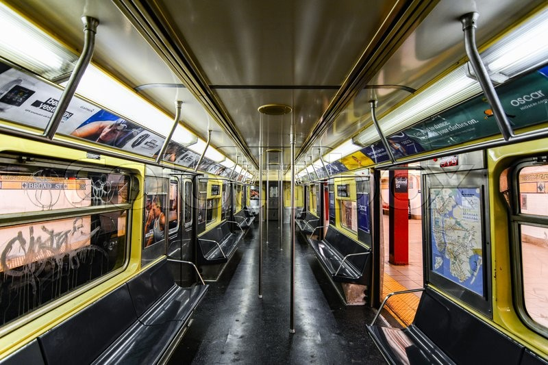 NEW YORK, NY - JANUARY 01, 2016: Inside an empty subway wagon with black seats. The subway of New York City is one of the oldest public transportation systems in the world, stock photo