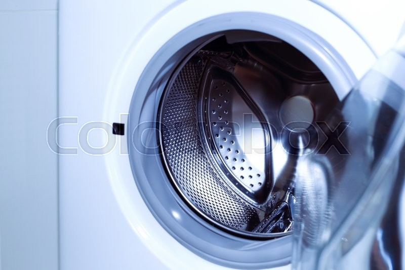 Stock image of 'White washing machine for housework clothes cleaning'