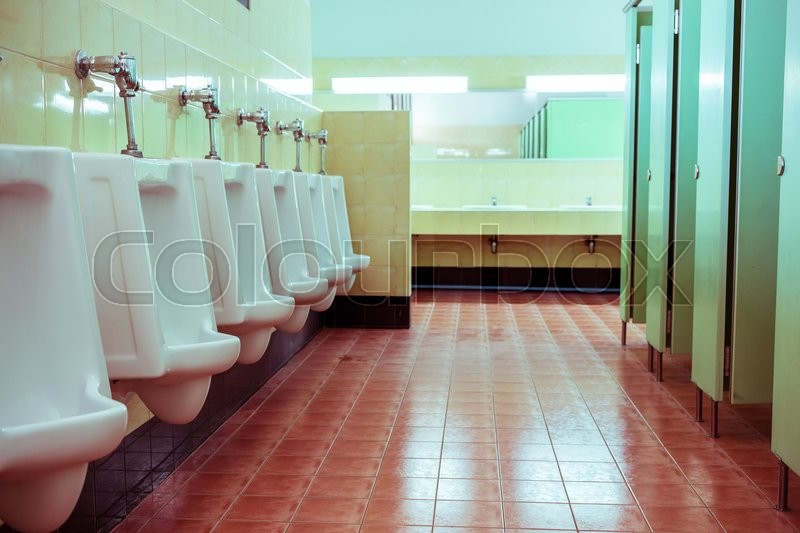 Stock image of 'Row white urinals in men's bathroom toilet'
