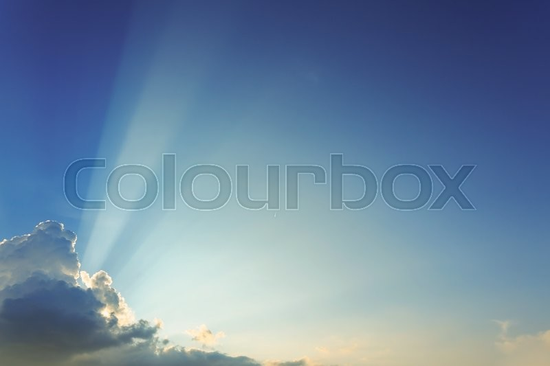Stock image of 'beautiful light on clear blue sky, light beam of sunlight through clouds above sunset sky'