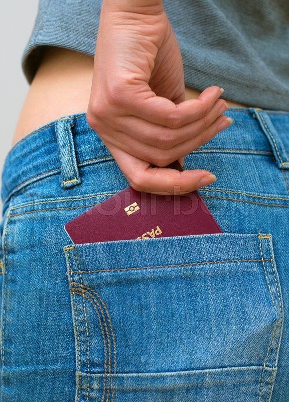 Stock image of 'Woman pulls out european passport from his back pocket.'