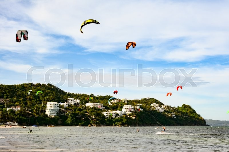 Stock image of 'BORACAY, PHILIPPINES - JANUARY 7, 2015 -  Tourists who enjoy kite surfing at a beach on the island of Boracay'
