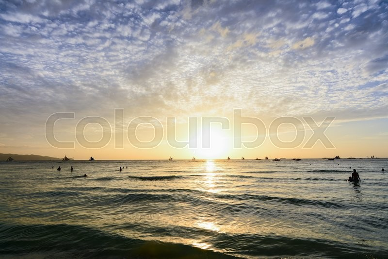 Stock image of 'People watching the scenic sunset in Boracay, Philippines'