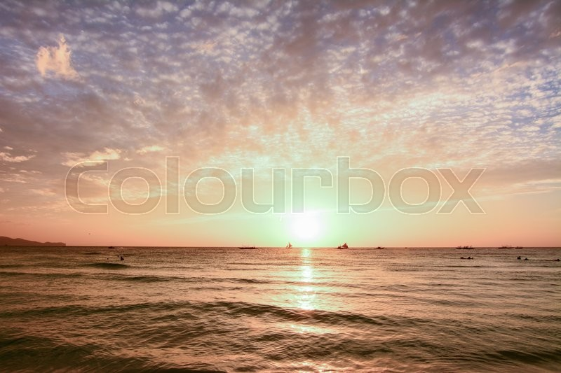 Stock image of 'The scenic sunset from the beach of Boracay island, Philippines'