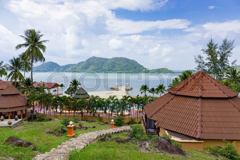 Stock image of 'Bungalows in a tropical garden on the beach'