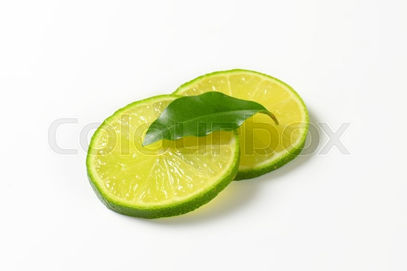 Stock image of 'Slices of fresh lime on white background'