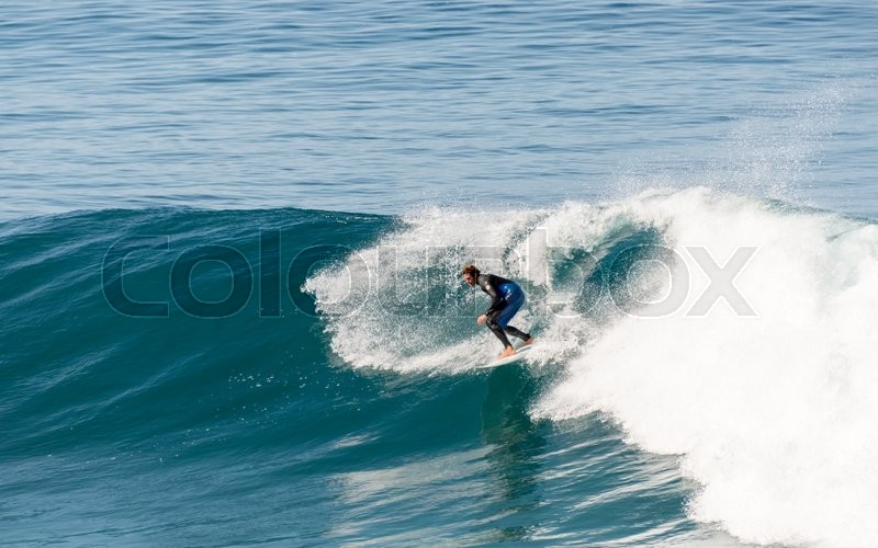 Stock image of 'CALHETA,PORTUGAL-MARCH 26 Unidentified boy surfing on the big waves at the east coast of Madeira on March 26,2016 in Sao Vincente,Sao Vincente had the biggest waves at the portugal coast'