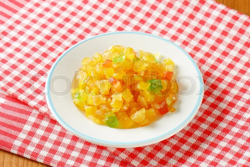 Stock image of 'plate of candied fruit on checkered dishtowel'