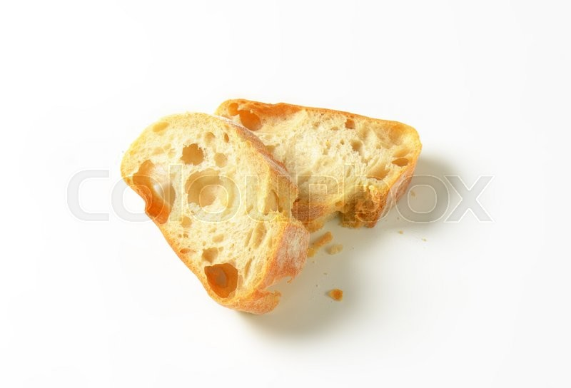 Stock image of 'Ciabatta bread slices on white background'