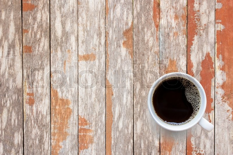 Stock image of 'Coffee cup on old wooden table background, top view. coffee time concept'