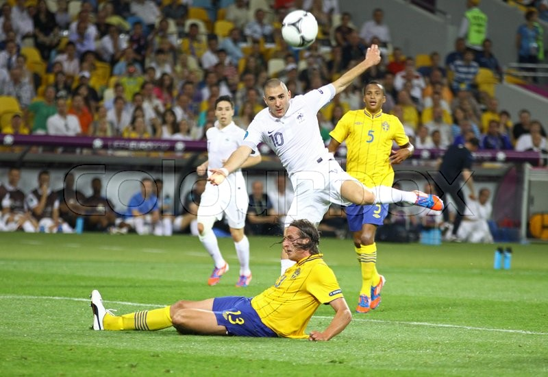 Editorial image of 'KYIV, UKRAINE - JUNE 19, 2012: Karim Benzema of France (in White) kicks a ball during UEFA EURO 2012 game against Sweden at Olympic stadium in Kyiv, Ukraine'