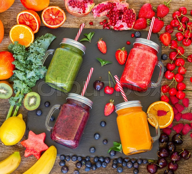 Stock image of 'Fresh smoothy drinks in glass jars with igredients'