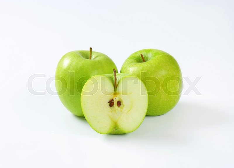Stock image of 'Two whole and half a green apple'