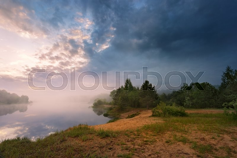 Stock image of 'Misty morning on the lake. Spring in Belarus'