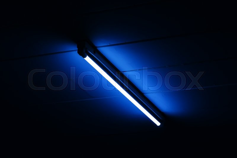 Stock image of 'Detail of a fluorescent light tube mounted on a wall with copy space for any design'