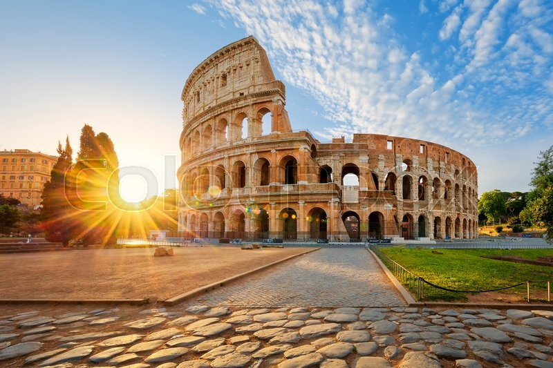 Stock image of 'View of Colosseum in Rome and morning sun, Italy, Europe.'