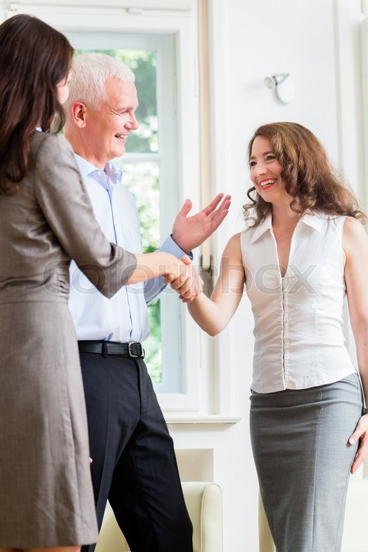 Stock image of 'Business people doing handshake after agreement'