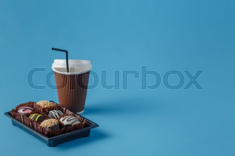 Stock image of 'cup of coffee to go and chocolate candy'