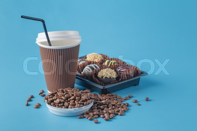 Stock image of 'Cup of coffee and coffee beans'