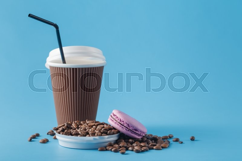 Stock image of 'Paper cup of coffee and coffee beans'