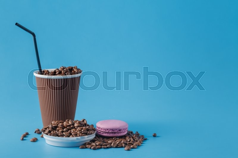 Stock image of 'One coffee to go and one macaroon'