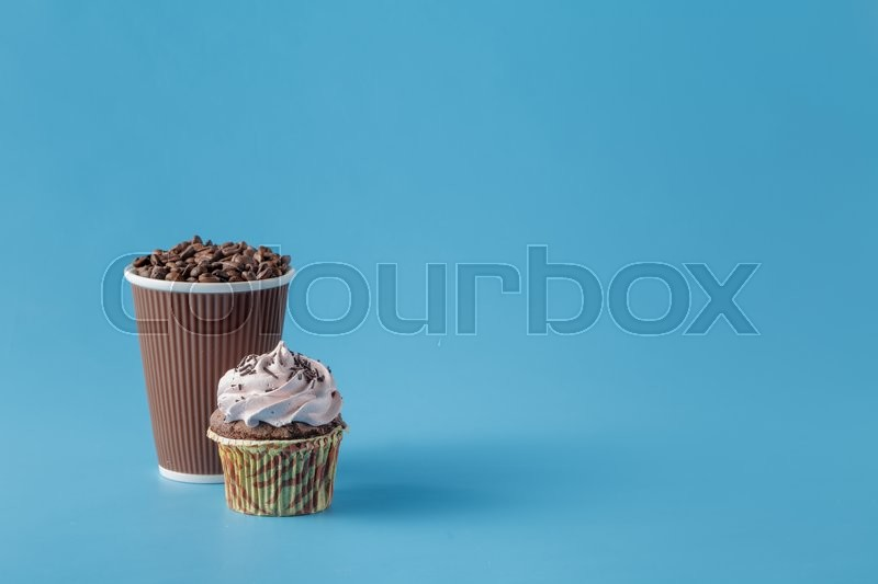 Stock image of 'Coffee to go concept. Cup with coffee bean on blue'