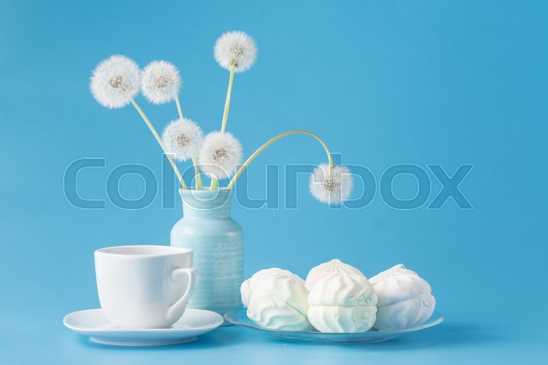 Stock image of 'marshmallow candies of different colors in the glass on the blue background'