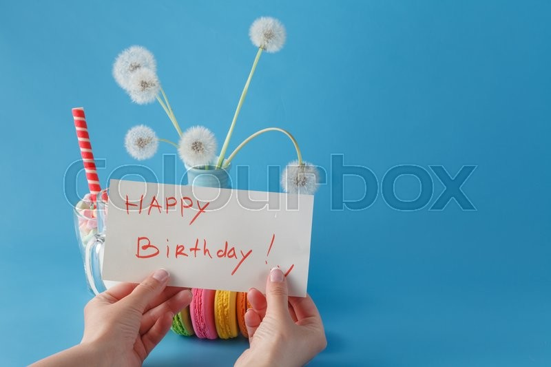 Stock image of 'Woman hold message happy birthday'