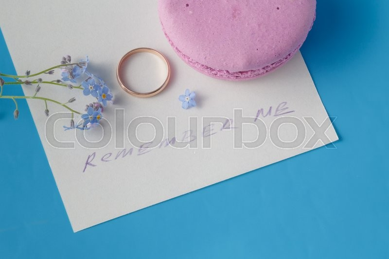 Engagement ring with forget-me-not / Romantic scene, stock photo