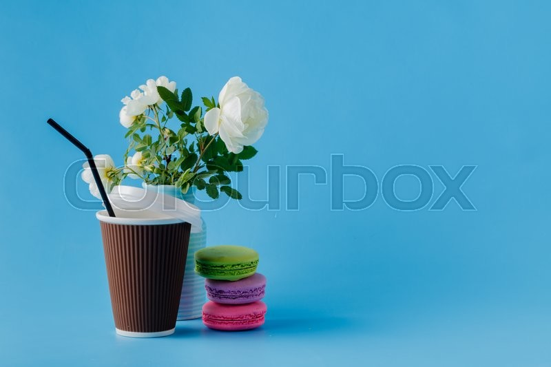 Stock image of 'Colorful macaroons and coffee cup'
