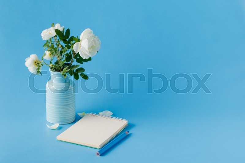 Stock image of 'Blank notebook with wild rose'