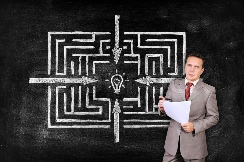 Stock image of 'businesswoman with paper and drawing labyrinth to success on blackboard'