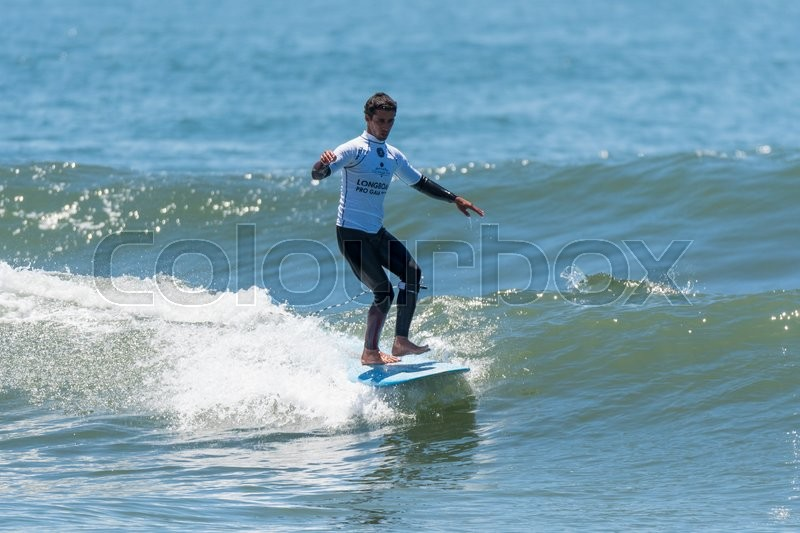 Editorial image of 'GAIA, PORTUGAL - JUNE 11: Augusto Olinto (BRA) at LQS Longboard Pro Gaia Men's Longboard Tour #3.'