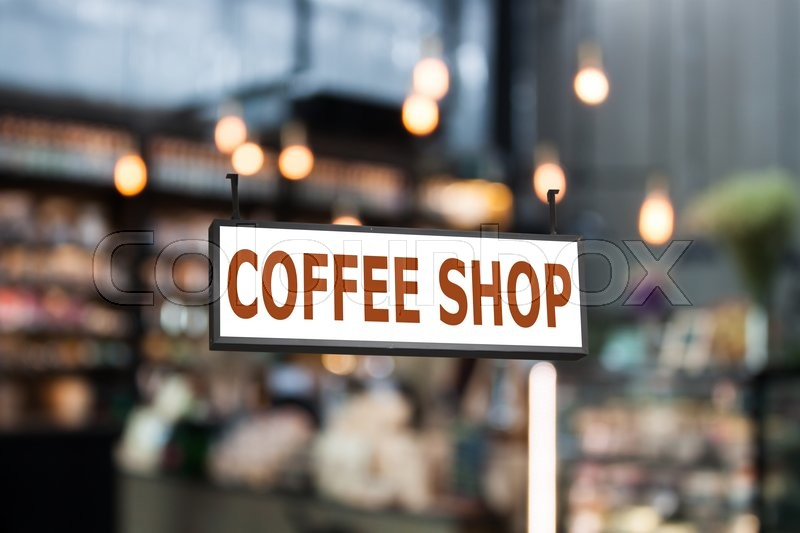 Stock image of 'Coffee shop signboard with coffee shop blurred background with bokeh'