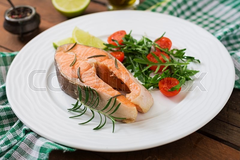 Stock image of 'Cooked on steam salmon steak with vegetables. Dietary menu. Proper nutrition.'
