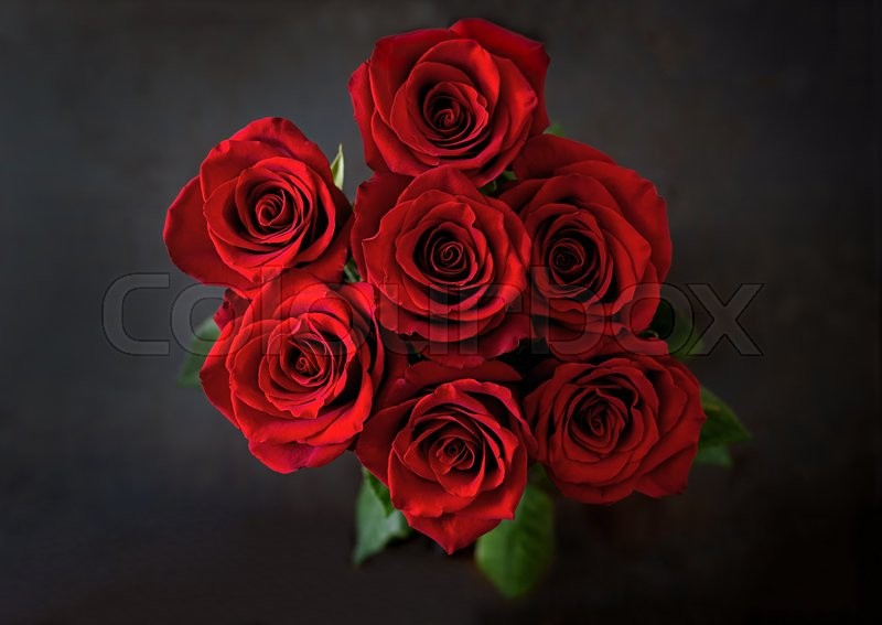 Stock image of 'Bouquet of red roses on a black background. Top view'